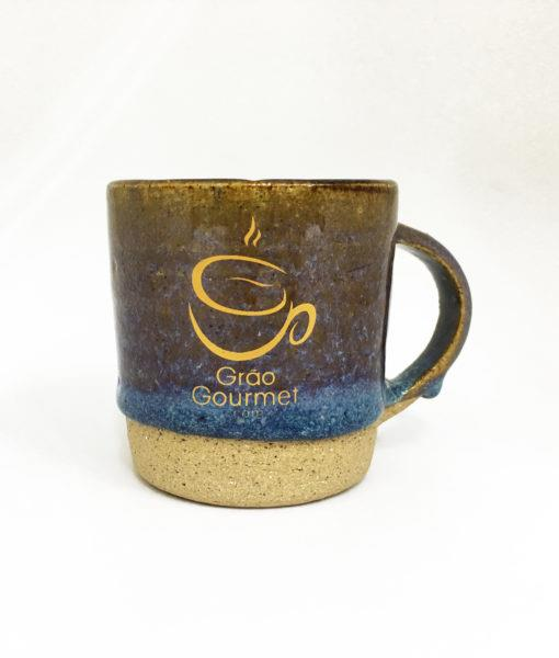caneca de cerâmica azul e marrom